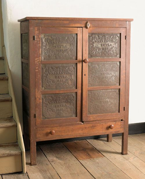 "Pennsylvania red stained pie safe with twelve punched tin panels, inscribed Warranted Extra 1857, above a single drawer supported by square legs, 54"" h., 39 1/2"" w."