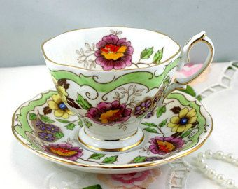 Vintage, Royal Albert Teacup & Saucer, Very Unique Floral Pattern, Gold Rims, Bone English China made in 1950s.
