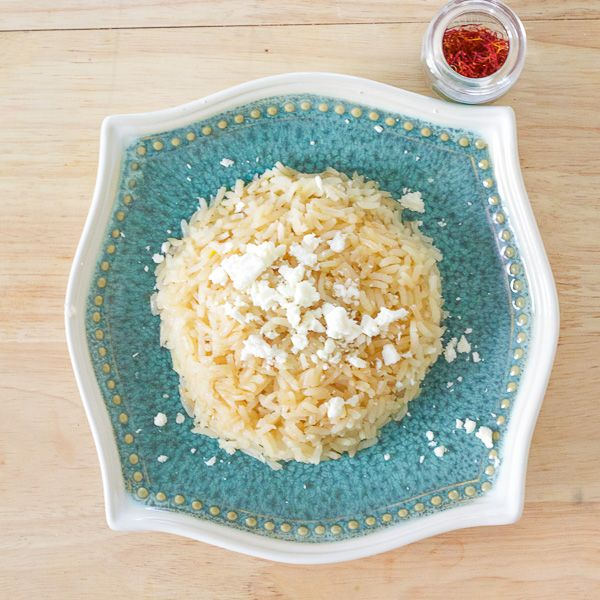 Making delicious rice pilaf doesn't need to be hard. This easy rice recipe is flavored with saffron, butter, broth, and topped with feta. A Greek rice dish.