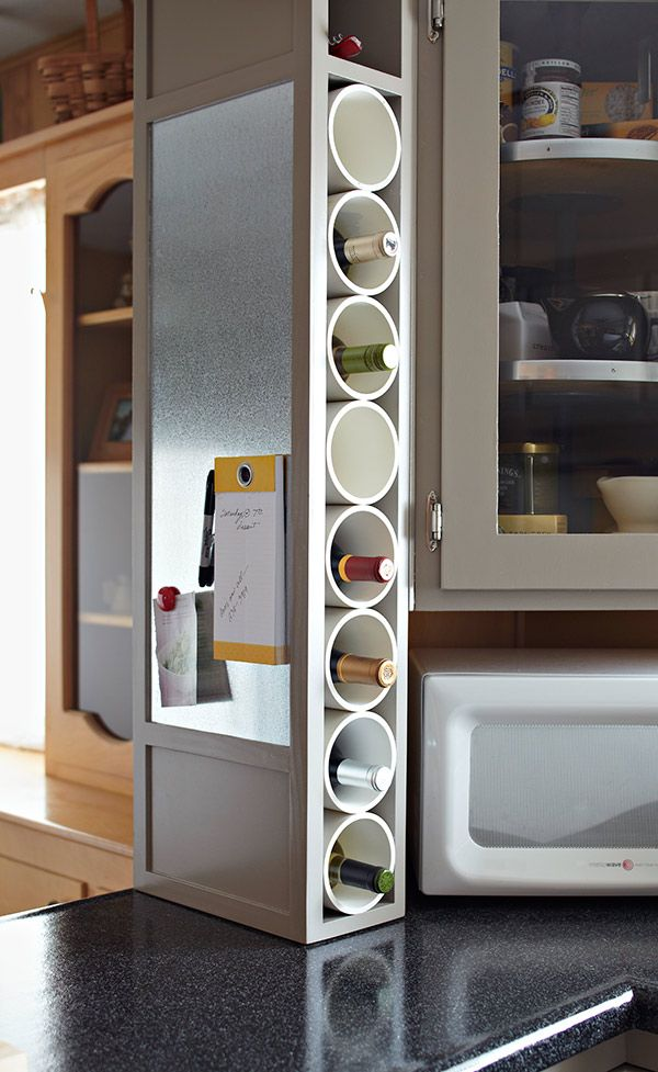 """Store and Stack Wine Rack:  """"Chablis meets PVC with this vertical wine rack. Galvanized side panels make it magnet-friendly, give it a high-tech, hip feel and ensure that it fits in as an attractive part of any kitchen redesign or remodel."""""""