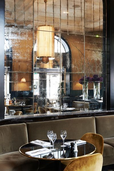 Le Flandrin, Paris | Joseph Dirand | antique mirrored wall | banquette seating