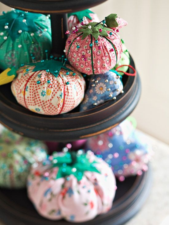 Pretty and Practical  A collection of vintage pincushions look sweet and charming when stacked on a pedestal.