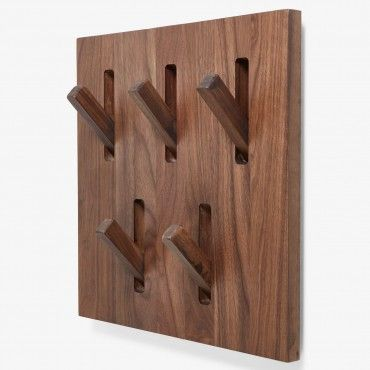 Ethnicraft Walnut Wall Bracket Hooks    Ethnicraft creates timeless, functional furniture by melding minimalist design with the tactile warmth of natural wood. These stowable walnut hooks are ideal for entryway organization and are pleasing to the eye even when not in use.