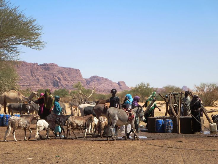 """Toubou nomads congregate at the """"Well of the Young Girls"""" in the Ennedi Mountains of northeastern Chad, Central Africa."""
