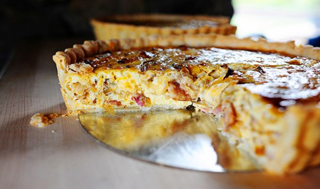 Hearty Cowboy Quiche includes bacon, eggs & cheddar cheese. the breakfast of Texas champions