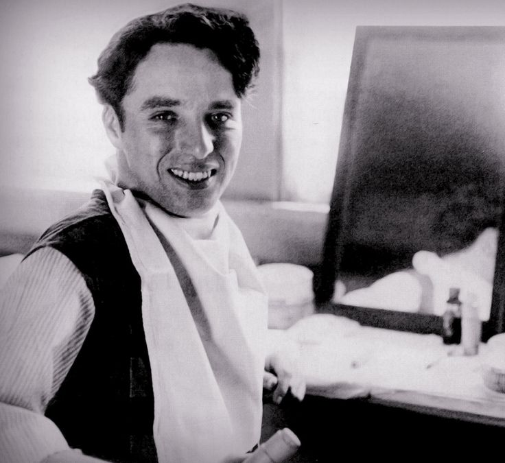 """For the longest time this photo of Charlie Chaplin, was in fact thought to be getting into tramp make-up, set of """"A Day's Pleasure"""" (1919), a couple of years ago, looking through magazines on the internet archives, this was actually on the set of """"The Count"""" (1916)."""