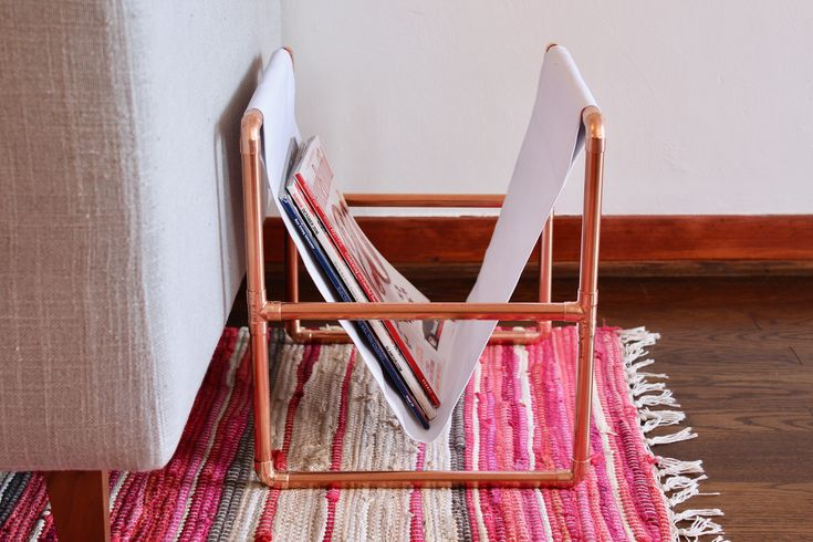 Make your own copper pipe magazine rack to corral all of those magazines that keep piling up! Simple, few supplies, and easy to make - click through for tutorial!
