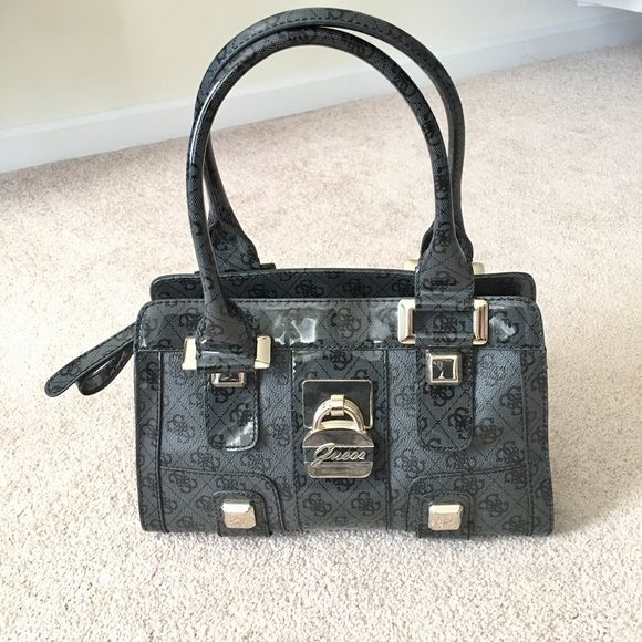 Guess handbag I used it twice- looks new! Guess Bags