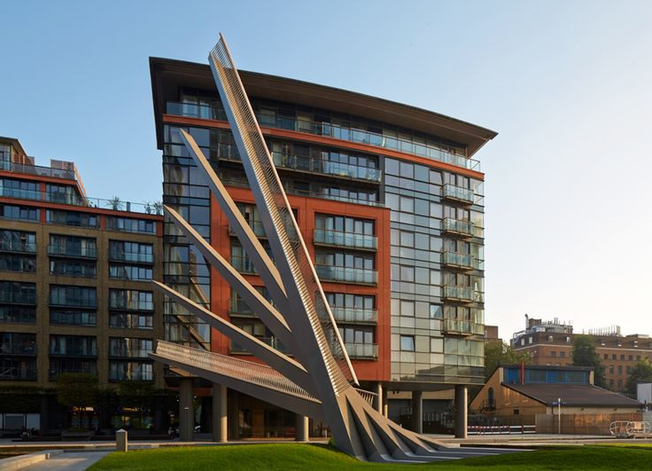 in london's merchant square, a mixed-use waterfront site at paddington basin, a movable footbridge designed by knight architects has opened to the public.