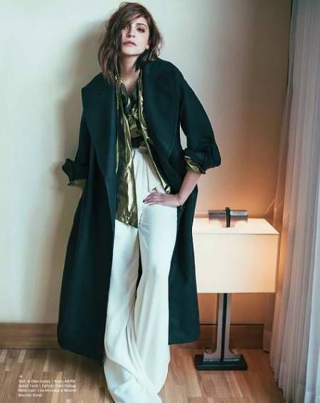 Anushka shines in this gold top by & Other Stories worn with a pair of slouchy, comfy looking white lounge flare pants from AMPM Fashion and a gorgeously green Fendi coat. #AnushkaSharma #Bollywoodfashion #celebstyle #DesignerWear