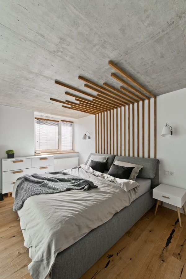Vertical line - the wooden accents above the bed lead the eye upwards and makes the room appear taller/larger.