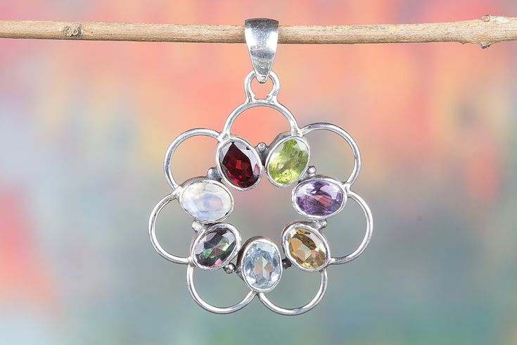 Gorgeous Multi Gemstone Pendant Handcrafted with Glimmering 925 sterling silver.This Adorable Pendantwill become your favorite go-to accessories to add a little sparkle to any outfit! .It is great for casual wear or for dressing up, this will make good sense in yourPersonality.It's all in how you choose to wear it!    Description  •Handmade item  •Material: sterling silver  •Stone:Citrine,Garnet,Labradorite,Carnelain,Blue Topaz,Peridot,Amethsyt  • Ships worldwide from India    All…