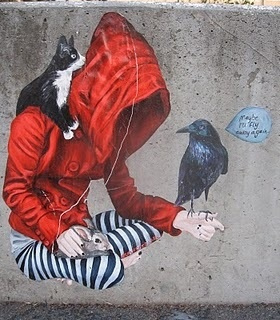 Urban Cake Lady #street art #grafitti - Girl in red hoodie with cat, raven and rabbit.
