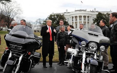 Europe threatens tariffs on Levi's jeans, bourbon and Harley-Davidson if Trump sparks trade war | Pictured: Donald Trump with Harley Davidson executives and union representatives at the White House last year
