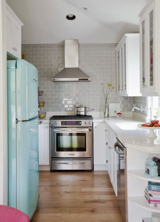 Gorgeous kitchen with a minty fresh fridge! From Living For Pretty.