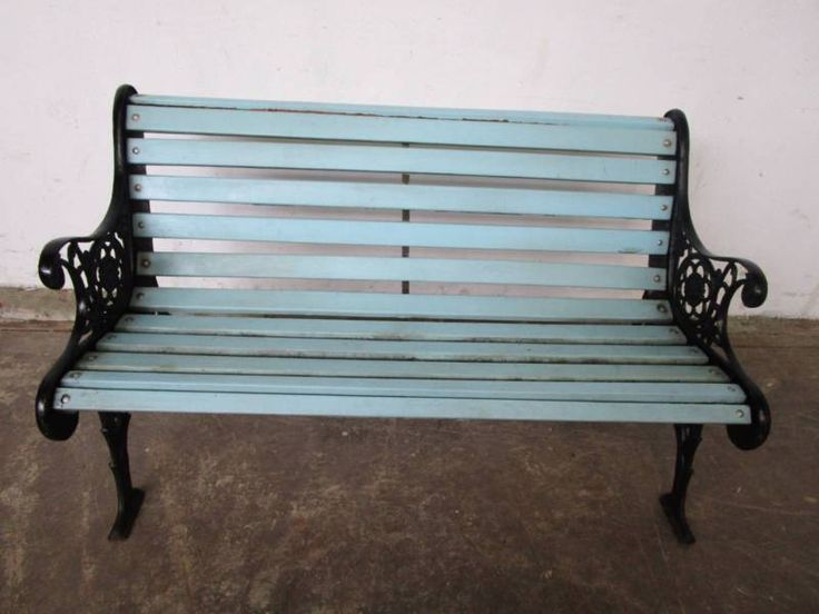 Vintage outdoor garden bench seat painted blue with black ornate cast iron endsfeet Solid and sturdy Some wearmarks  Measures 1265cm x 63cm x 78cm high, seat ..., 1132640295