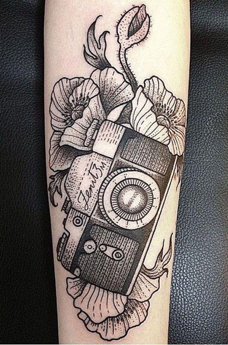 Black work 35mm film SLR camera tattoo. Artist unknown                                                                                                                                                     More