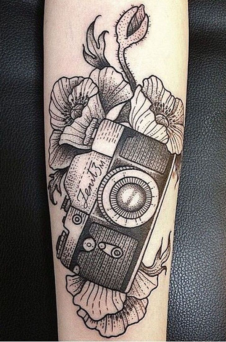 Black work 35mm film SLR camera tattoo. Artist unknown