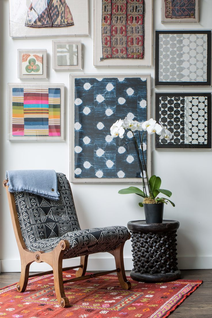 Mudcloth upholstered chair with framed mudcloth & other ethnic fabrics