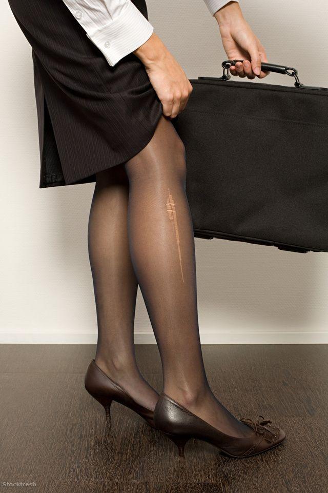 stockfresh 1378108 businesswoman-with-a-stocking-ladder sizeM