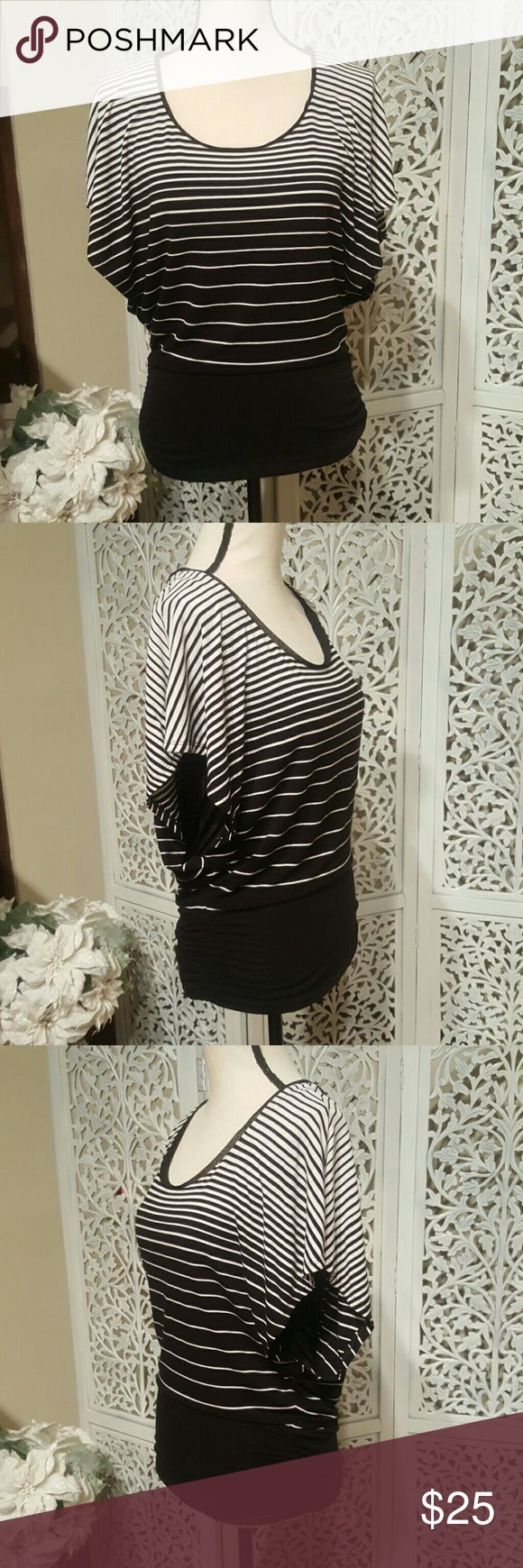 White House Black Market Striped Top Black and white striped top with batwing sleeves and banded bottom.  Very figure flattering.  Shell: 95% rayon, 5% spandex. Lining: 95% polyester, 5% spandex.  Please feel free to make an offer through the offer button below. White House Black Market Tops