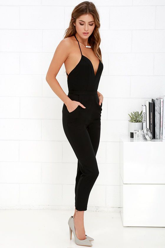We love the NBD Leaving Black Jumpsuit because it is a perfect outfit in itself! A sexy, plunging neckline is supported by thin straps that form a unique, adjustable T strap above an open back. Soft woven fabric creates a princess-seamed bodice, banded waist, and trouser pants with zipper cuffs. Rounded front pockets. Hidden back zipper and clasp.