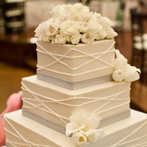 Cake - I like this with purple and white flowers and a purple band