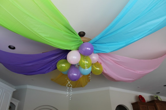 Decor from my 7 year old's birthday party - cheap plastic tablecloths and balloons. Easy and the girls loved it.