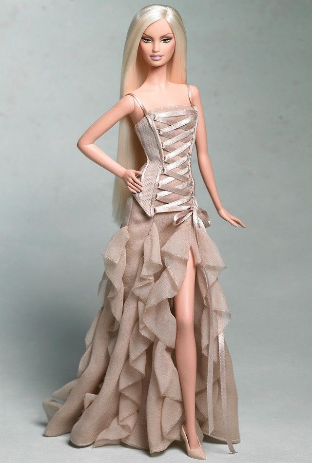 Versace Barbie® Doll (2004) This Barbie is so Versace. I remember Beyonce wearing this exact dress.