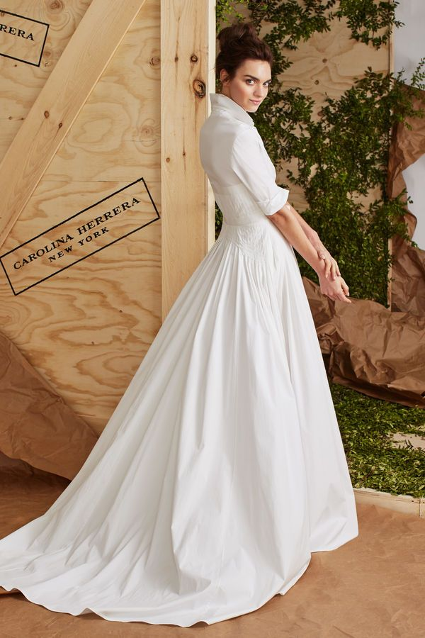 The shirtdress silhouette is one of the biggest trending styles this year, from casual day looks to wedding dresses. This urban-chic wedding dress is styled with a popped collar, updo, and a thin belt to emphasize the pintucks around the waistline.