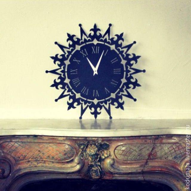 "Wall clock ""Liilia"" 50cm. Made of metal. Roman number. Metal in interior. Clock. Metal. Steel."