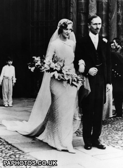 Alec Douglas-Home, Lord Dunglass MP, leaves church with his bride Elizabeth Alington in 1936.