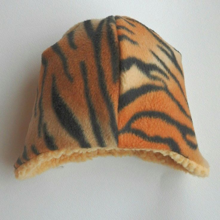 More warm and cute winter beanies available! Tiger, mid grey and giraffe. Come visit our shop and fall in love!