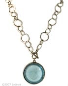 Silver Plate Aqua Intaglio Necklace     Our popular necklace now in a beautiful transparent Aqua German glass intaglio. Shown here in Silver Plate, very pretty for Spring/Summer. Large pendant is 1 1/2 inch diameter, chain length is 20 inches. Also available in our signature bronze metal. Other colors available by request, call. Silver plate over bronze.