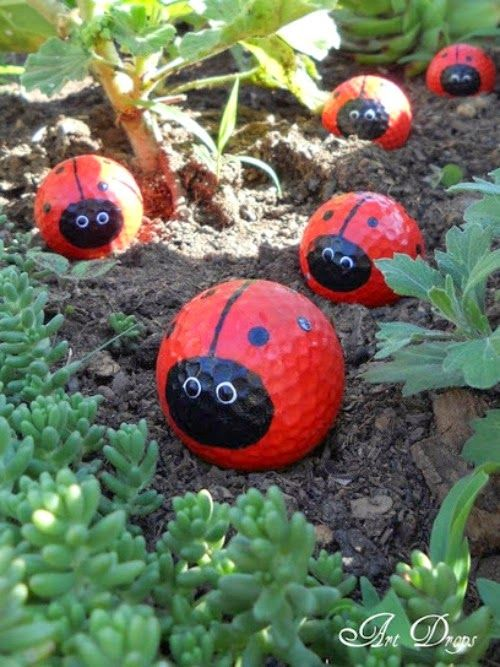 Golf ball ladybugs. If the dog wouldn't haul them off these would be cute in the flower beds.