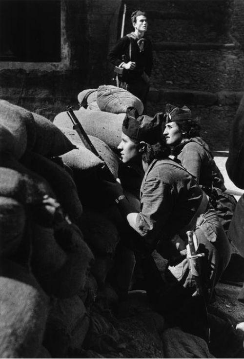 Spain. Anti-fascist militia women defending a street barricade, Barcelona, Spanish Civil War, 1936. // by Robert Capa