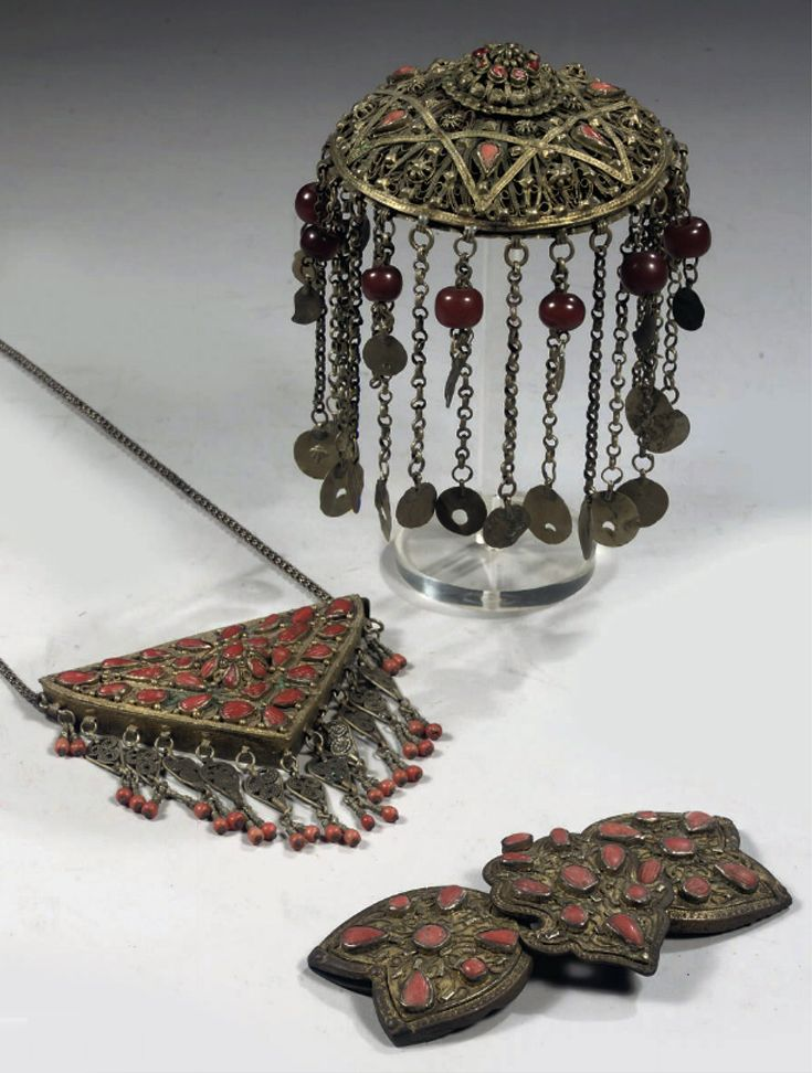 A coral inlaid silver filigree 'tepelik' (headpiece), 'toka' (belt buckle) and 'muska' (pendant for an amulet).  Women jewelry.  Late-Ottoman, 19th century.  Probably from a workshop in Safranbolu.
