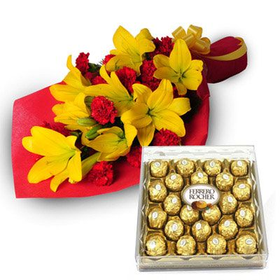 Bunch of 5 stem of Yellow Lilies & 16 Red Carnations nicely wrapped in Red color paper packing with yellow Ribbon bow and 300gm Ferrero Rocher #Chocolate #Box. http://www.fnp.com/flowers/exotic-hamper/--clI_2-cI_1123-pI_23670-i_23312.html