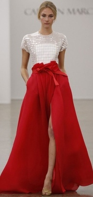 Carmen Marc Valvo. Another look at his red skirt, this time showing THE SLIT!