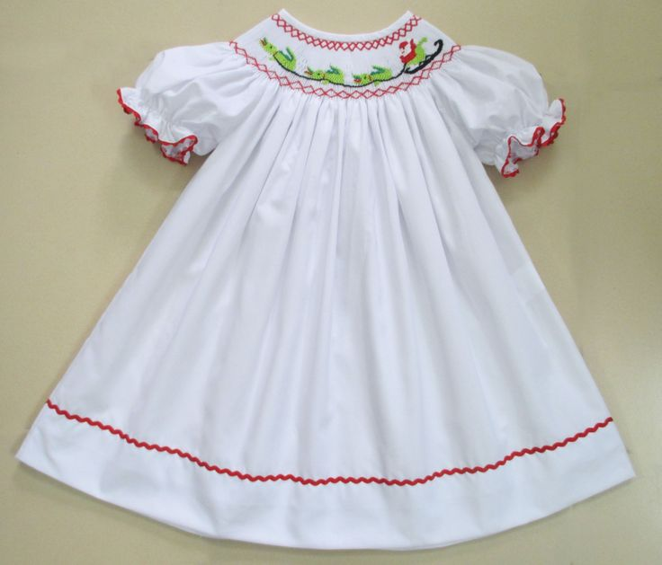 Southern Smocked Company specializes in boutique smocked children's clothing for girls and boys sizes three months to six years with prices you will love. #ShopNOLA2014