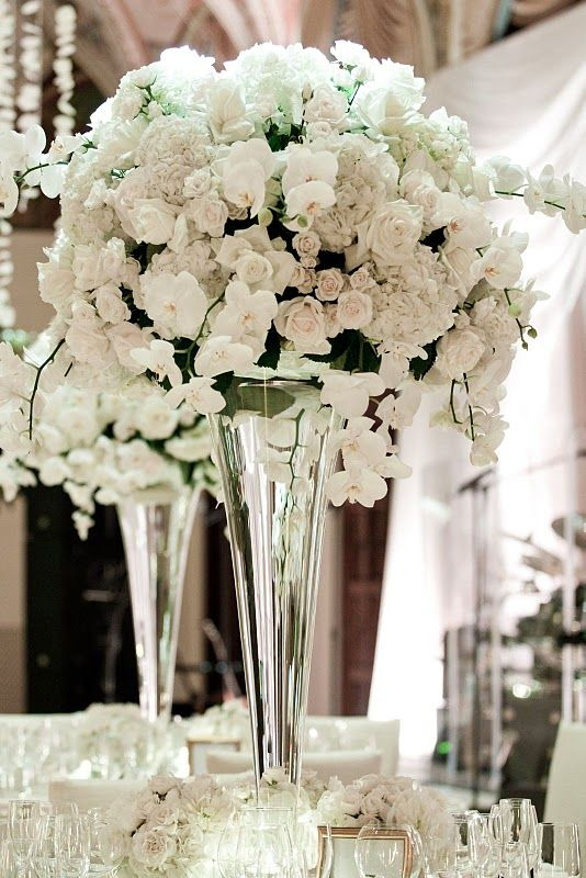 Orchids and roses/all white wedding