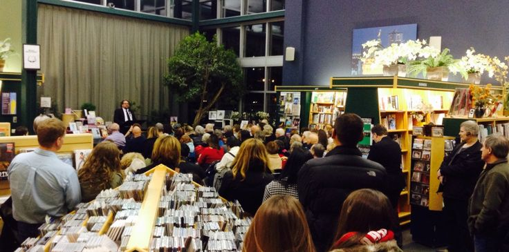 Mike McIntyre addressing a very large crowd at the launch of his book, Mike on Crime. (Winnipeg, Nov 19, 2014.)