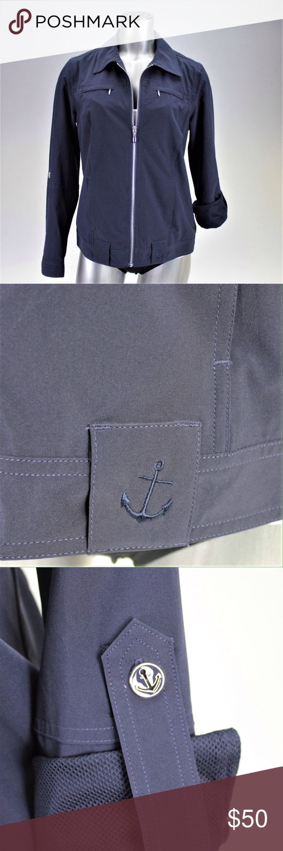 Navy Blue Lightweight Anchor Jacket This adorable windbreaker style jacket can be worn with the sleeves rolled or down. It's perfect for any breezy day or boat outing with anchor accents on the buttons and bottom hem. Fabric content in photos. Lana Lee Jackets & Coats