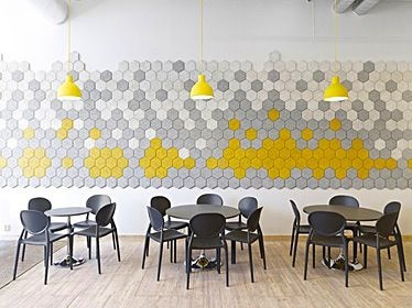 Great cafeteria with Form Us With Love hex wall tiles