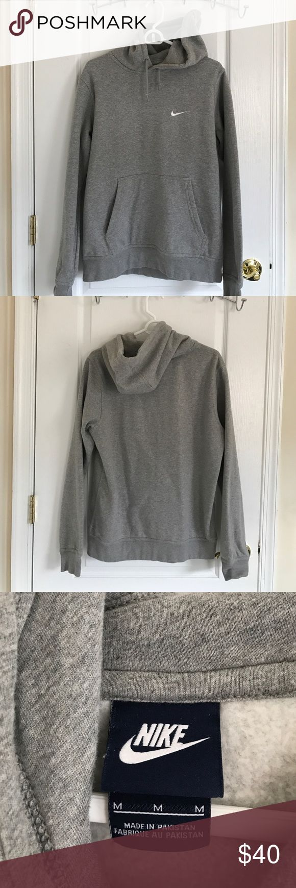 Nike grey women's hoodie size M Nike grey hoodie worn once gently size M fits true to size. Nike Tops Sweatshirts & Hoodies