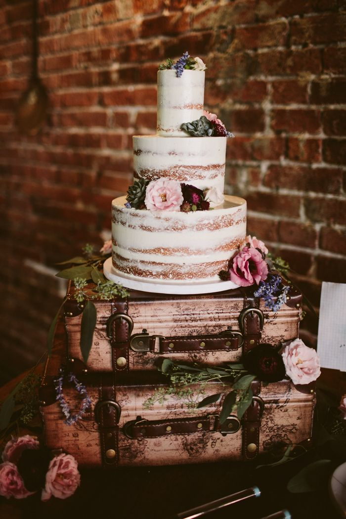 rustic, flower-embellished wedding cake | Image by Kelly Giarrocco Photography