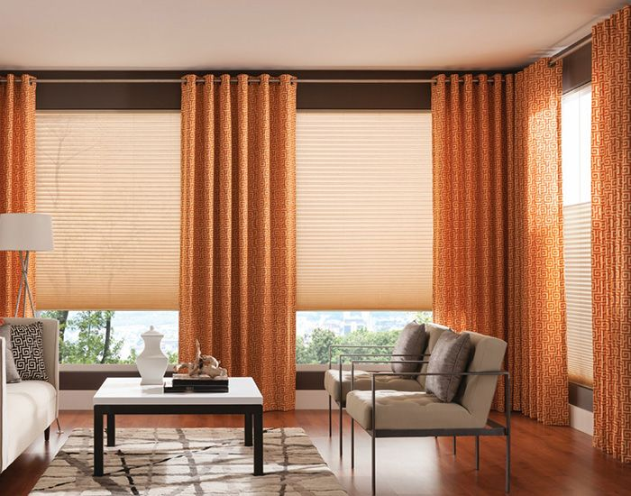 create a dynamic aesthetic by layering cellular shades with colorful drapery panels for increased energy efficiency window