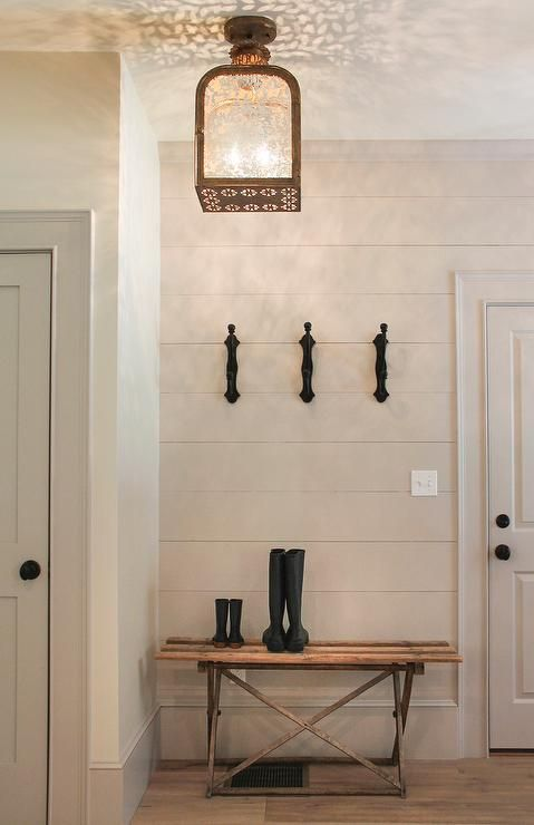Cottage Foyer With Gray Shiplap Siding And Lantern Light