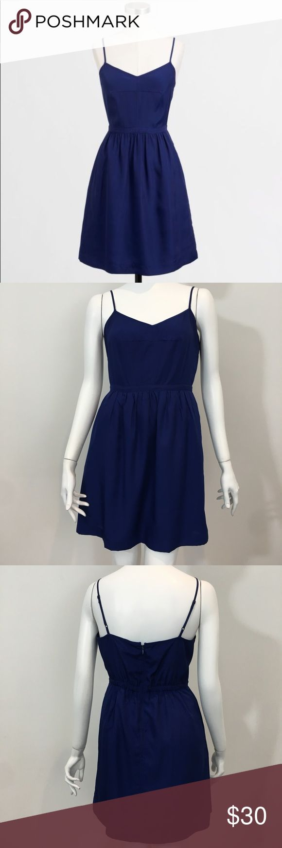 """J. Crew Classic Blue Cami Dress Size 4 Beautiful J. Crew Classic Cami Dress  Excellent used condition no flaws  Size 4  Bust: 16"""" Length: 32"""" Waist: 14"""" Navy Blue  Adjustable spaghetti straps  100% polyester  Fully lined   ☒ Please no low offers or trades.  ツ Bundle & Save! J. Crew Dresses Mini"""