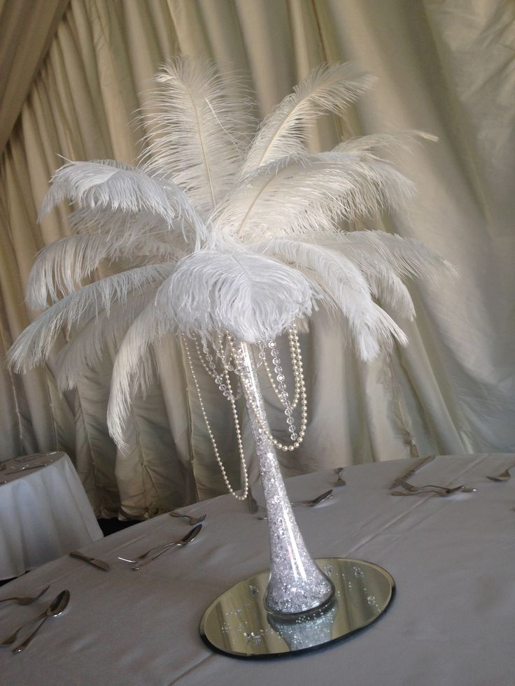Deluxe white feather Eiffel Tower centrepiece with pearls, crystals and led lights.  Hire in the Midlands from Make It Special Events. http://www.makeitspecialevents.co.uk/